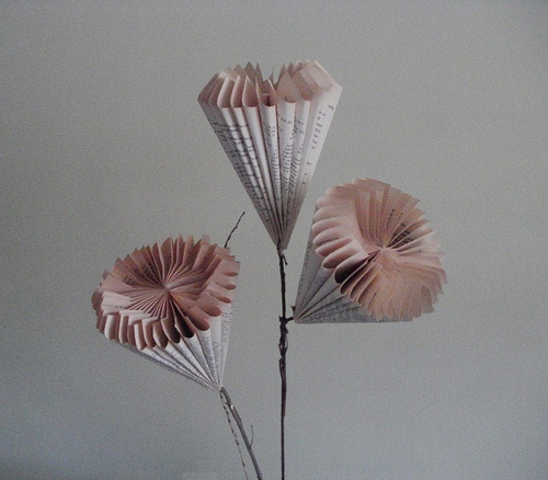 sculpture of flowers made of book pages