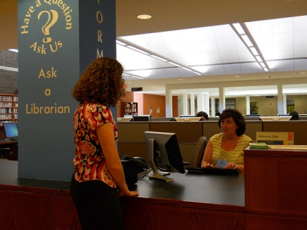 a librarian helping a patron