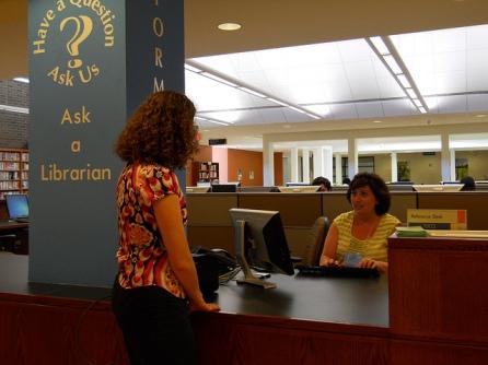 a librarian helping a patron