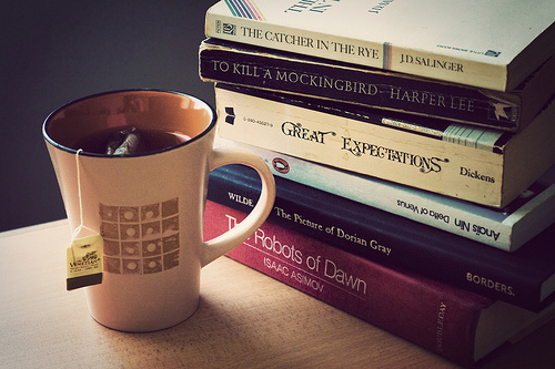 image of tea cup next to books