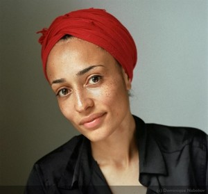 portrait of author zadie smith in a red head covering